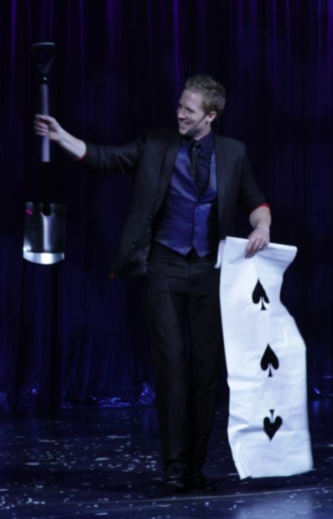Corporate Comedy Stage Magician Martin John appearing a spade!